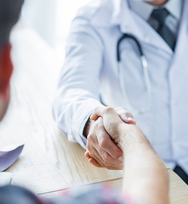 Urgent Care Physician Meeting with Patient